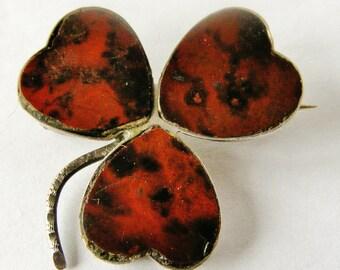 Antique sterling silver and serpentine shamrock brooch