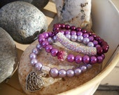 Set of Three Burgundy Purple and Fuschia Beaded Stretch Bracelets with Charm Accents