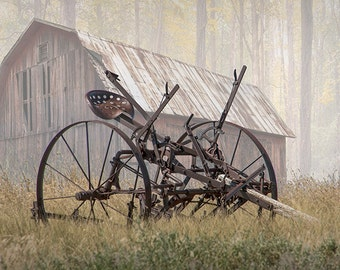 Old Farm Equipment on a foggy morning by a Red Barn near the Woods No.74953BG A Rural Fine Art Agriculture Landscape Photograph