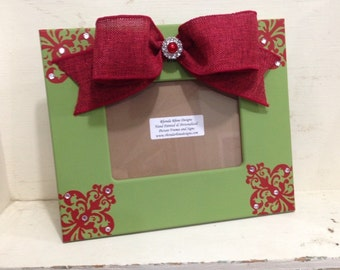 Green Christmas Frame with Red Corner Designs and Burlap Bow