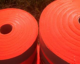 Fabric rolls for ragrugs, quilting, crafting.  Neon Orange