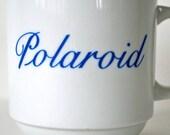 vintage white and blue Polaroid coffee tea mug