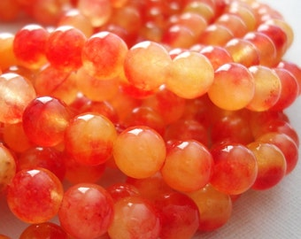 Natural Two Tones Orange Jade Beads - 8mm  - 14 inch Strand.