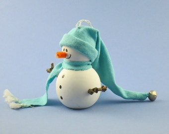 Ornament: Wooden Snowman with Floppy Turquoise Hat and Scarf with Jingle Bell