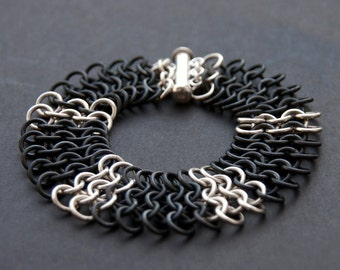 Sterling silver and black niobium chunky chainmaille cuff. Black chainmaille. Chainmaille bracelet. Handcrafted bracelet. Modern jewellery.