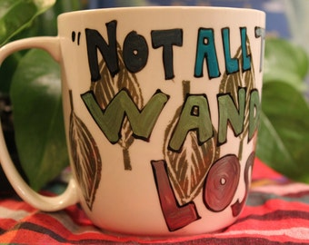 "J.R.R. Tolkien ""Not all those who wander are lost"" Small white mug with leaves - Hand painted, block lettering - LOTR"