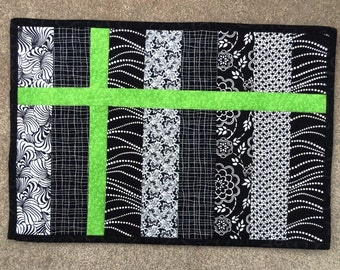 Set of four black, white and green placemats ready to ship