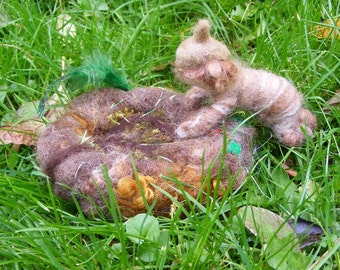 Root Child in a nest - a needle and wet felted posable figure in the Waldorf style - green