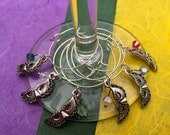 Set of 6 silver Mardi Gras masquerade wine glass charms adorned with dangling Swarovski crystals