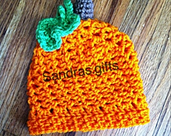 Crochet pumpkin hat with stem and leaf