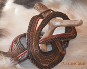 antler and pine needle one of a kind sculpture