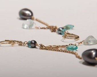 Gold drop earrings with black pearl, aquamarine and apatite