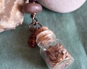 a little ritual~incense filled spell bottle pendant with smoke fired bead & Baltic amber