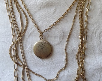 Vintage necklace five strand with round locket