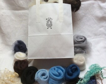 Needlefelt kit. Includes washed British fleece, 10 shades of Merino tops,sponge,wool curls, 2 needles and instructions. Winter colourway