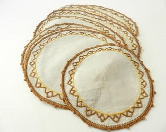 Vintage cream gold mustard yellow linen doilies embroidered design crocheted hem 8 PCS