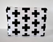 XL Womans cosmetics make up pouch travel bag in geometric cross canvas print in black and white.
