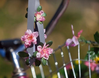 Reflective bike streamers with pink flowers