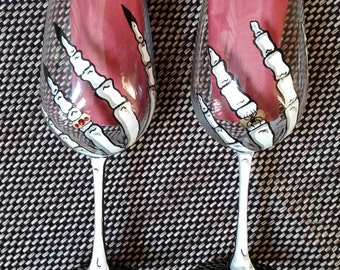 His and hers Skeleton hand Halloween hand painted wine glasses.