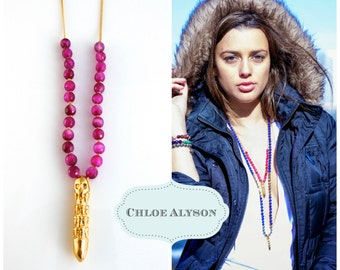 Hand-knotted faceted fuchsia agate on 18K gold filled chain with bullet with skulls pendant
