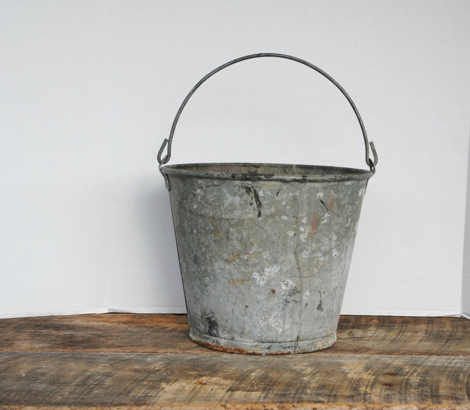 vintage galvanized pail or bucket with handle outdoor garden