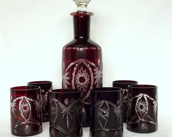 Czech cut glass decanter and six glasses, ruby glass cut to clear