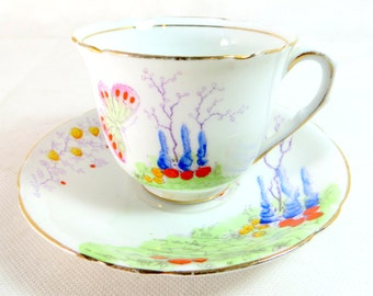 Art Deco Duo, Melba Bone China Handpainted Fantasy Butterfly Garden Cup and Saucer 1948-1951
