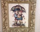 Reserved for Emma Vintage Framed Hummel Evans Print Girl and Boy under umbrella and Girl whispering in boys ear 2 Framed prints