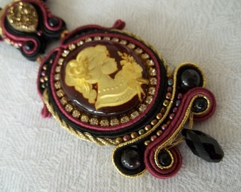 For Elise. Soutache embroidery necklace with inside carved naturl amber cabochon