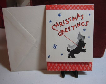 Colorful art deco 1930's-40's unused christmas card with black scotty dog on a leash with snow flakes falling