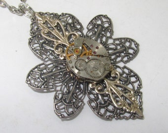 Steampunk Gothic filigree necklace with vintage watch movement and antiqued silver filigree settings. Gift under 30 Dollars