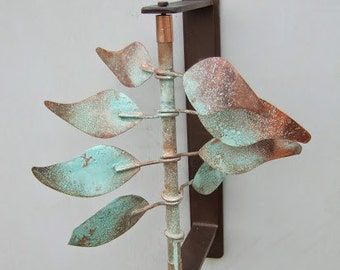 "Wind sculpture ""Style Leaves"" mounts to wall, post, fence or any vertical surface and turns in the wind.  Sale price!"