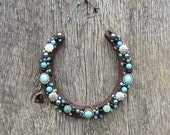 Rusty beaded horseshoe covered with new and vintage turquoise, silver and black beads brings good luck to newlyweds or homeowners