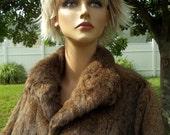 Full length vintage women's coney skin coat