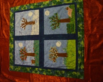 """Batik Wall Hanging of the Four Seasons. All cotton materials of seasons, window strips,border, and backing. Measures 39.5"""" wide &43.5"""" high."""