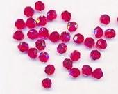 Twelve dazzling limited edition Swarovski crystals: art 5000 - 8 mm - light siam AB 2X