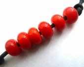 handmade lampwork glass bead, orange spacers