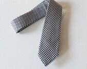 Dots Against Grey Neck Tie