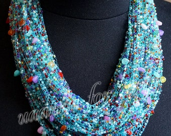 Turquoise necklace handmade. Technique crochet. 50 sets of beads of different colors and shapes.