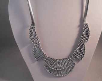 Silver Tone Pendants Bib Necklace on a Silver Tone Chain
