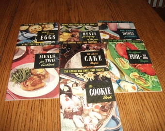 Set of Seven vintage cookbooks published in 1952.
