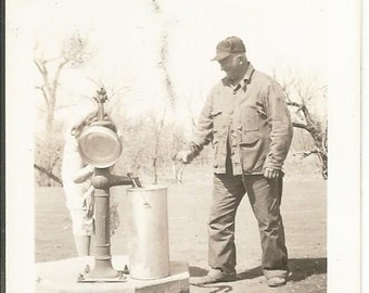 Vintage 1900's Man Getting Water Photograph