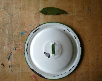White and Green Graniteware Lid
