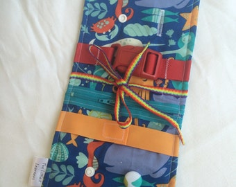 Ocean Busy blanket - a buckle, snap, zip, Velcro, and button toy - fine motor skills practice