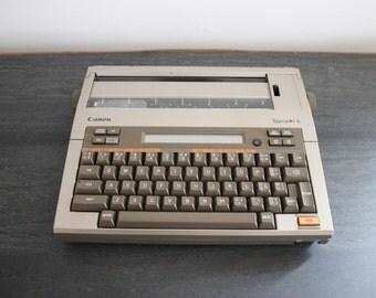 vintage Canon Typestar 6 electric typewriter - battery operated typewriter
