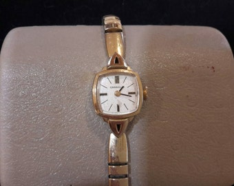 Caravelle Ladies Wind Up Watch,  Gold Tone,  Working,  Stretch Band