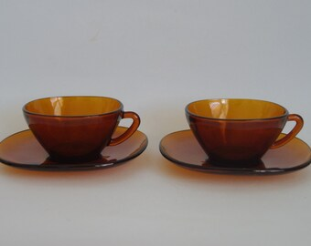 French pair (2) teacups & saucers circa 1970s Vereco Amber tempered glass.