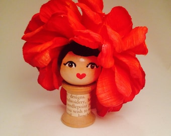 Vintage spool doll with flower hat