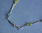 Lia Sophia Bracelet, silver colored with blue, pink and green stones, new with Box, 12inches long