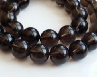 """1-15.5"""" Strand Smokey Quartz Smooth 12mm Rounds ( 33 beads)"""
